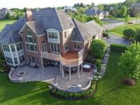 This spectacular home overlooks the Merit Club Golf