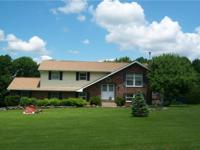 Bilevel home located in Sterling Twp on 1.7 Acres. Home