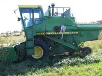 parting out two john deere combines with heads, one