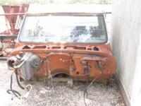 It is a 1970 Chevy A/C cab. The right side rocker panel