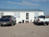 Doublewide and one acre with electrical, waterwell and