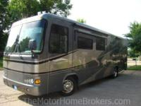 Model 36PDD with dual slide-outs. Sharp Coach ! Built