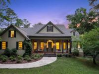 Travel a winding gravel driveway to this inviting and