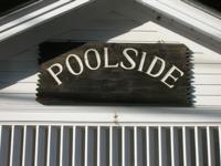 As the name implies, Poolside Condominiums are