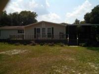Charming 4BR/2BA home situated on 1.89 acres in Pierce