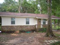 Nice home on beautiful acre lot north of I-10 in Grand