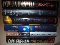 Six Like New Hardback Novels.  No writing,