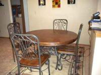 Oak Dining room table with 4 chairs and pull out leaf.