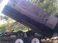 2005 Carson dump trailer has ply wood panels on the