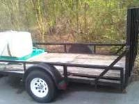 6x12 rear loading trailer. Tires are in excellent