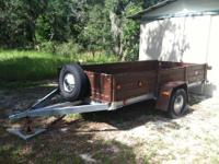 6x12 trailer in very good shape. Wood decking solid