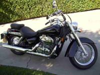 2007 Honda Shadow Aero 750CC black with red pinstripe.