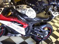 This is a Superpsort Legal 2008 Yamaha R6. It has two