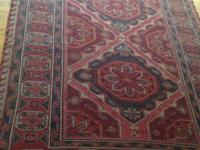 This gorgeous rug was handwoven in Dagestan. This big