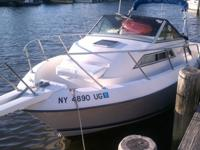 1991 236 Wellcraft coastal walkaround. This boat has a