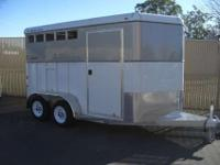 2 horse Double R trailer for sale. It has a swing out