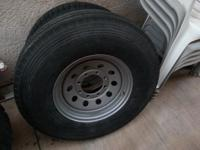 New unused light truck or trailer tire and silver