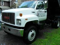 This Dumptruck is a 1993 GMC Topkick Dumptruck. It runs