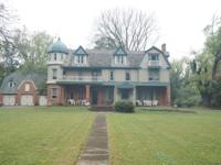 One of a kind estate home on 10.25 acres. Features a