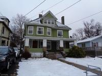 Large colonial with open front porch on deep lot. As is
