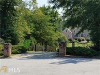 CUSTOM BUILT ESTATE ON 2.9 ACRES WITH LAKE ACCESS.
