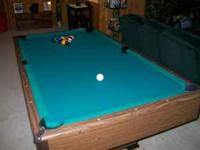 7 foot Sears pool table. Slate top with ball return.