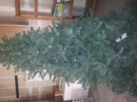 Three piece 7 foot Noble Fir X-Mas tree. Only used for