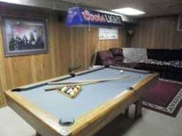 7ft. Brunswick oak pool table good condition. sticks