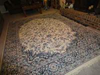 For sale. Large decorative rug. Measures 7 ft 10 inches
