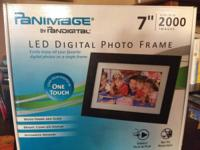 New, unopened digital photo frame.  Bought this for an