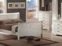 This sleigh bedroom suite has a clean white finish.