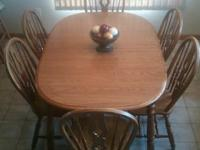 Oak dining table and 6 solid oak coordinating chairs w/