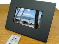 Like new in box - black 7 inch photo frame. $50. Will
