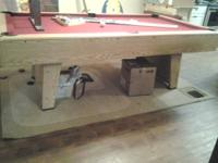 For sale is a slate pool table in good condition. It