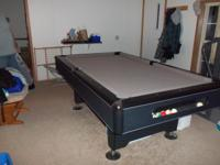 This is a 7' slate top Imperial Eliminator pool table.