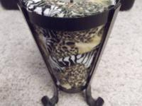 Tall, decorative animal print candle. Collage of animal