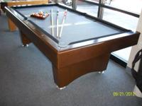 I am selling a 7' modern style slate pool table. It has