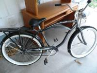 We have a LIKE NEW Men's Schwinn Delmar Cruiser Bike;