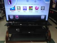 "BEAUTIFUL 70"" 3D LED SMART TV FOR SALE $1200. STAND"