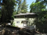 Big home in charming natural setting. Decks off both