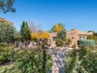 Sited on a lush 1+ acre lot in the heart of the