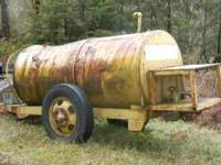 700 Gal Diesel Tank on trailer. $450 OBO Dent on top
