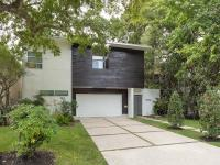 This home is a warm, modern villa with garden gates and