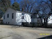 This home and 3.8 acres of land on 70th and Kipling has