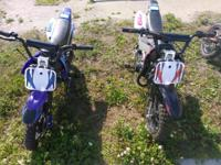These two red and blue 70cc dirt bikes at $699 each