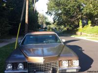 4DOOR BROWN WITH BLACK LEATHER!  472ENGINE IT IS A