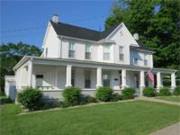 SIMPLY REDUCED! This grand two story farmhouse is