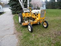 1972 mid size Cub ,runs and drives like new,5ft Woods