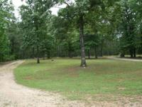 For sale is a 9.4 acre wooded lot with trailer and