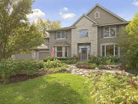 Stunning 5BR/4BR two story on arguably the best lot in